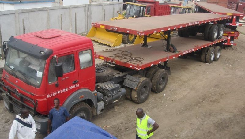 Congo, pointe noire customer inspect their beiben 2638 tractor truck and bogie suspension semitrailer